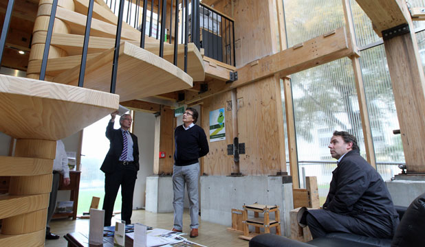 GUIDED TOUR: Dick Thomas of Colliers, left, takes Creative NZ members Chris Herbert and Stephen Wainwright through the earthquake-resistant house.