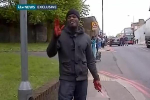 ''You people will never be safe,'' a man with bloodied hands carrying a machete and knife told a nearby cameraman.