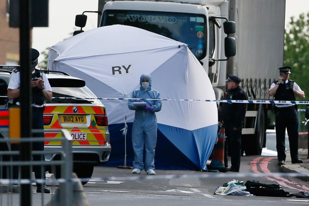 A tent covers part of the gruesome killing scene in South London.