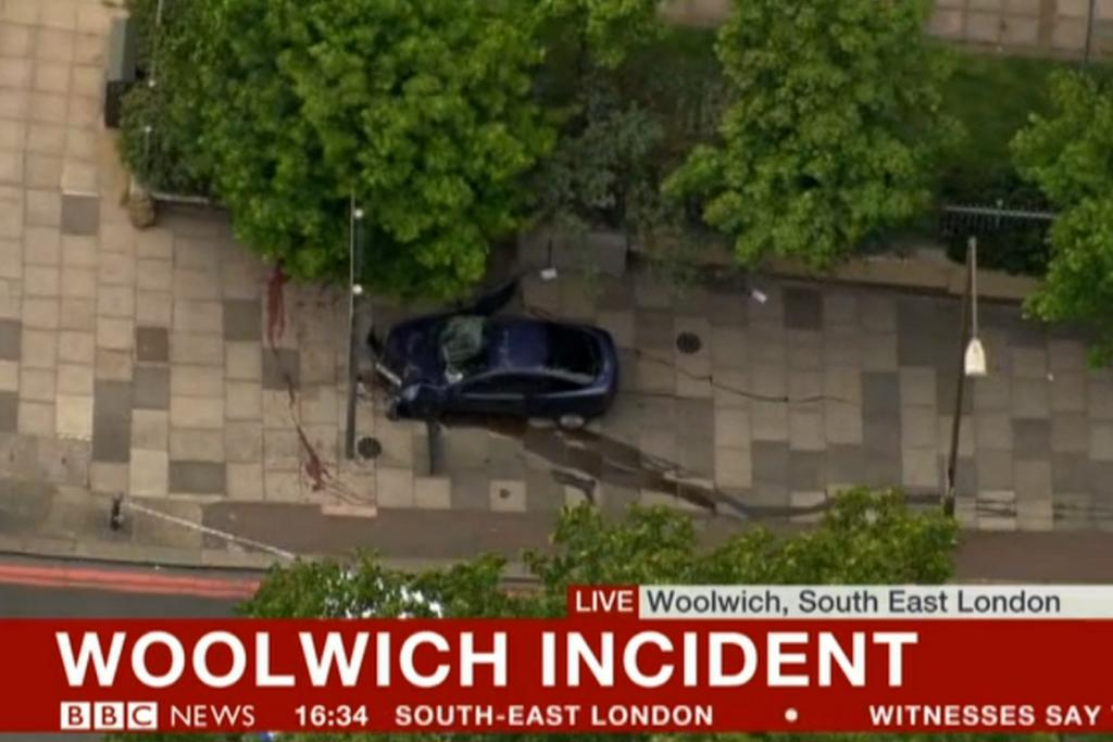A screen grab showing a crashed car and a line of blood related to the Woolwich incident.