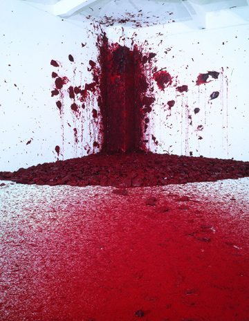 BLOODY BLAST: Bullets of burgundy wax splat against a pristine white wall every 40 minutes.
