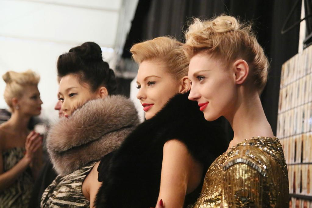 RUNWAY READY: Models at the Fall 2013 Badgley Mischka show - done but still slightly 'messy' hair is hot right now.