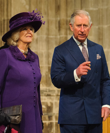 QUICK, RUN THIS WAY: Prince Charles and Camilla eye the exit.