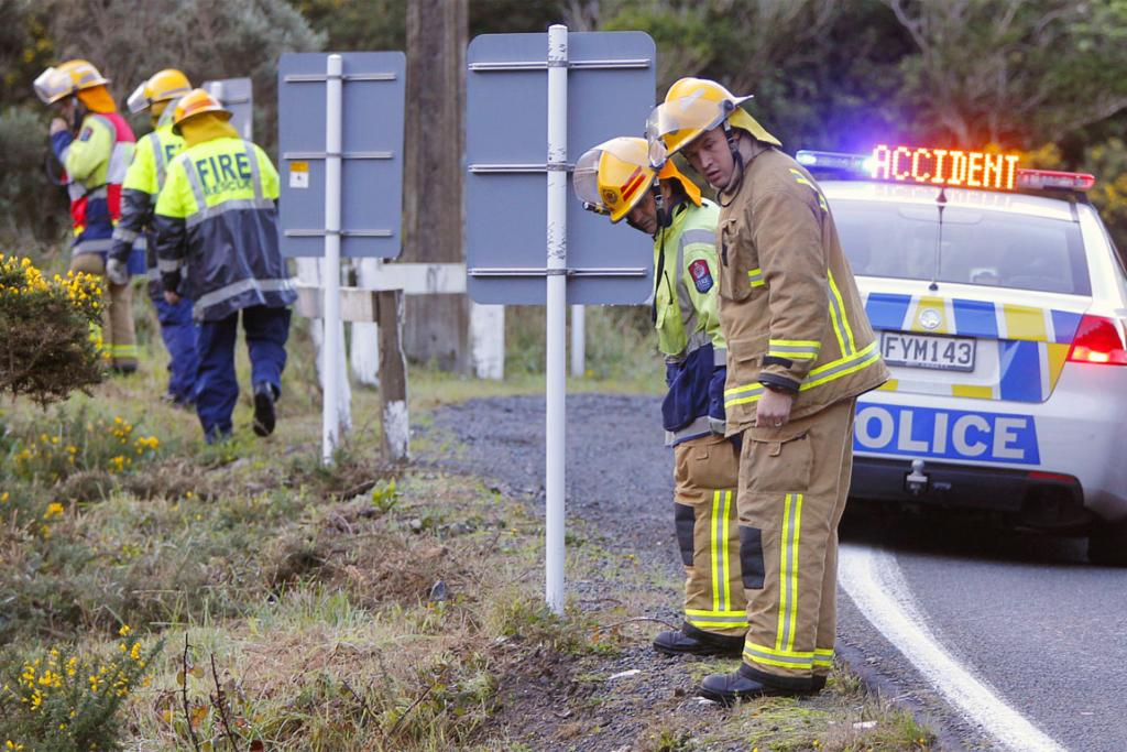 Emergency services search the scene of the crash.