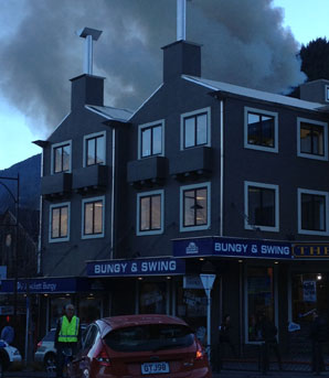 FLAMES FOUGHT: Shotover St in Queenstown has been blocked as a kitchen fire takes hold in the Station Building.