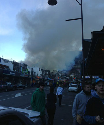 BLAZE: People have lined the streets in Shotover St, Queenstown, to view a fire at the Station Building.
