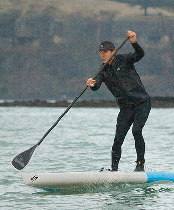 SUITS ME: Jonathan Eaton QC takes time out from work paddle boarding on Lyttelton Harbour.