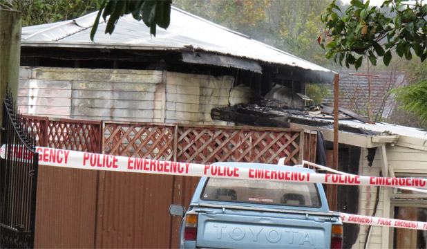 CORDONED: A man's body has been found inside a burning shed in Hokitika.