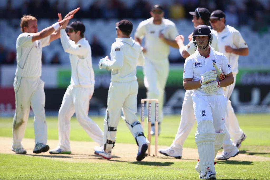 Neil Wagner is high-fived by team-mates as Jonathan Trott heads back to the pavillion.