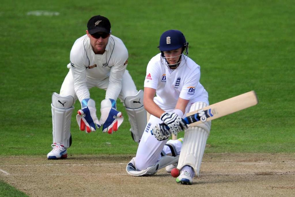 Joe Root plays a reverse sweep in front of Brendon McCullum during his innings of 104.