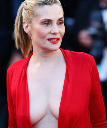 Emmanuelle Seigner caused a stir with her plunging red dress.