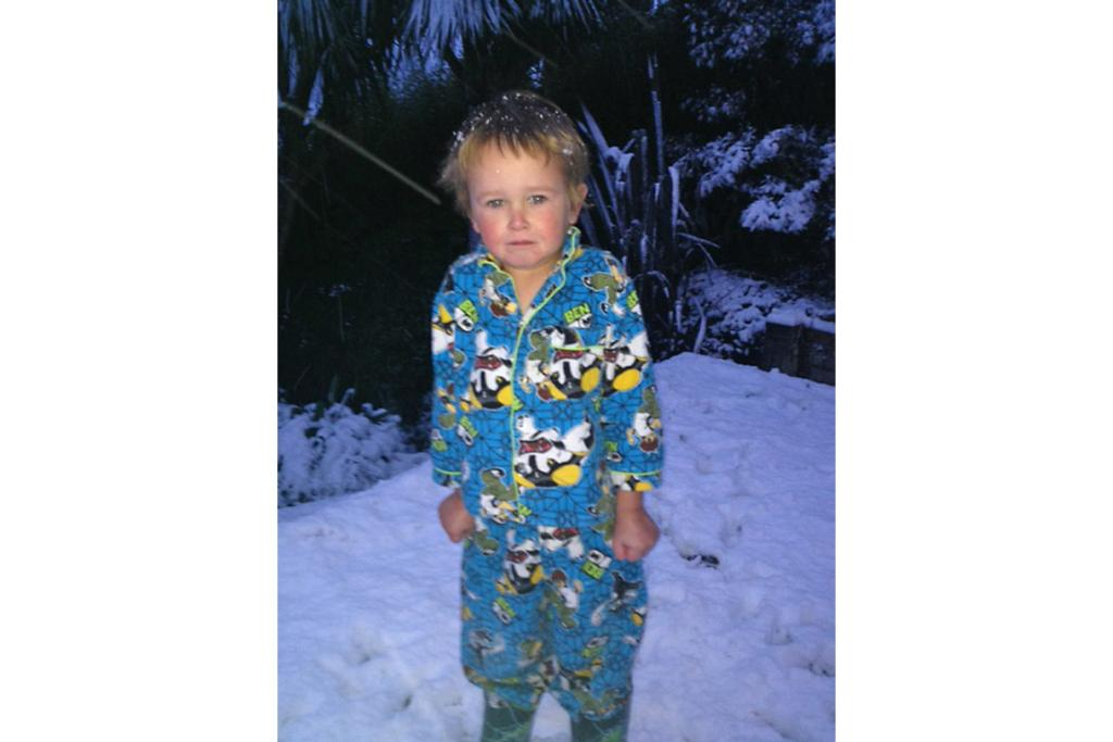 Young Joshua gets an early-morning taste of winter.