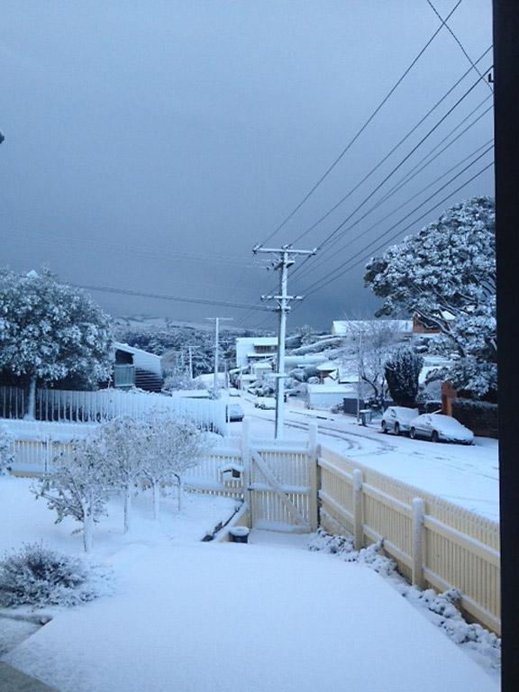 Dark clouds hang over Dunedin after the overnight snow flurry.