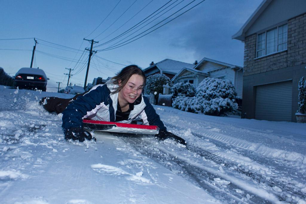Grace Hepburn makes the most of the snow on Dunedin's streets.