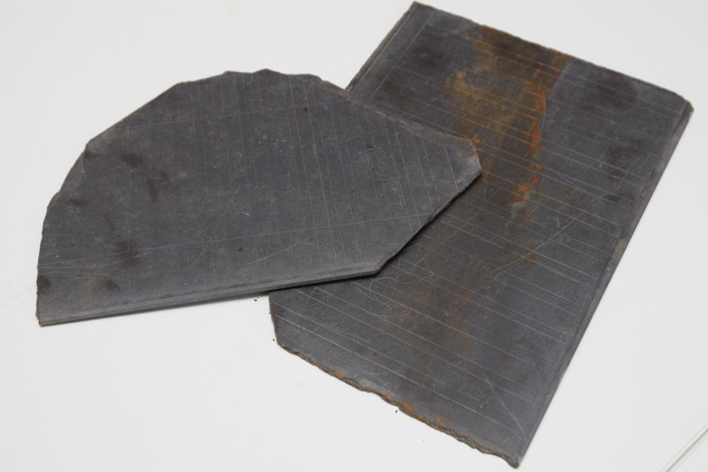 LESSONS: Old school slates were found in the buried well.