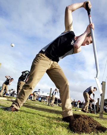 HOT COMPETITION: Contenders for the Rural Bachelor of the Year race to put in a post at the Fieldays at Mystery Creek.