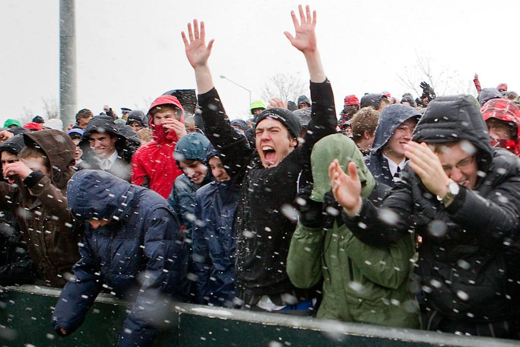 BLIZZARD: While some cheer the action, others in the crowd try to hide from the freezing wind and sleet.