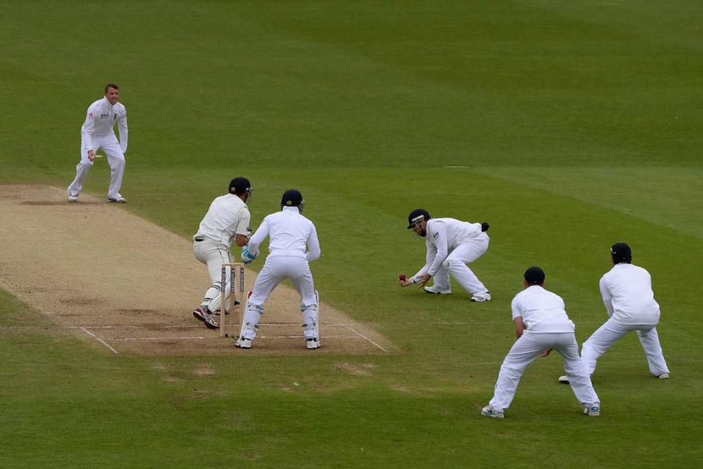 Doug Bracewell is caught by Ian Bell at silly mid-off, ending a stubborn resistance.