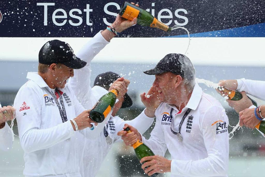 England players spray champagne on each other during the test series presentations at Headingley.