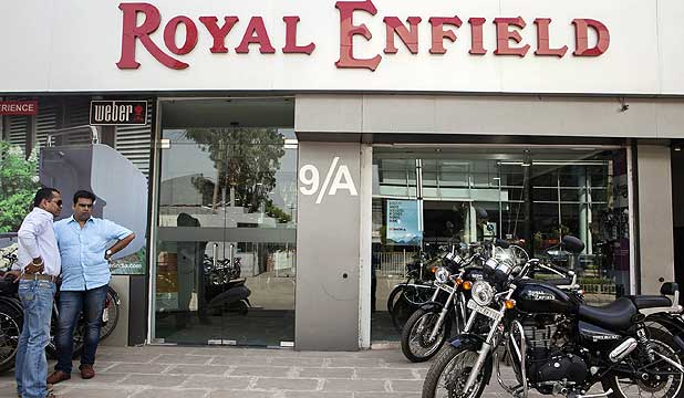 Customers look at Royal Enfield Thunderbird 500 motorcycles on display outside the flagship dealership in Gurgaon, India.