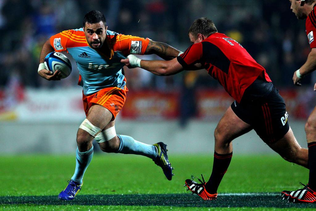 Liam Messam charges ahead against the Crusaders.