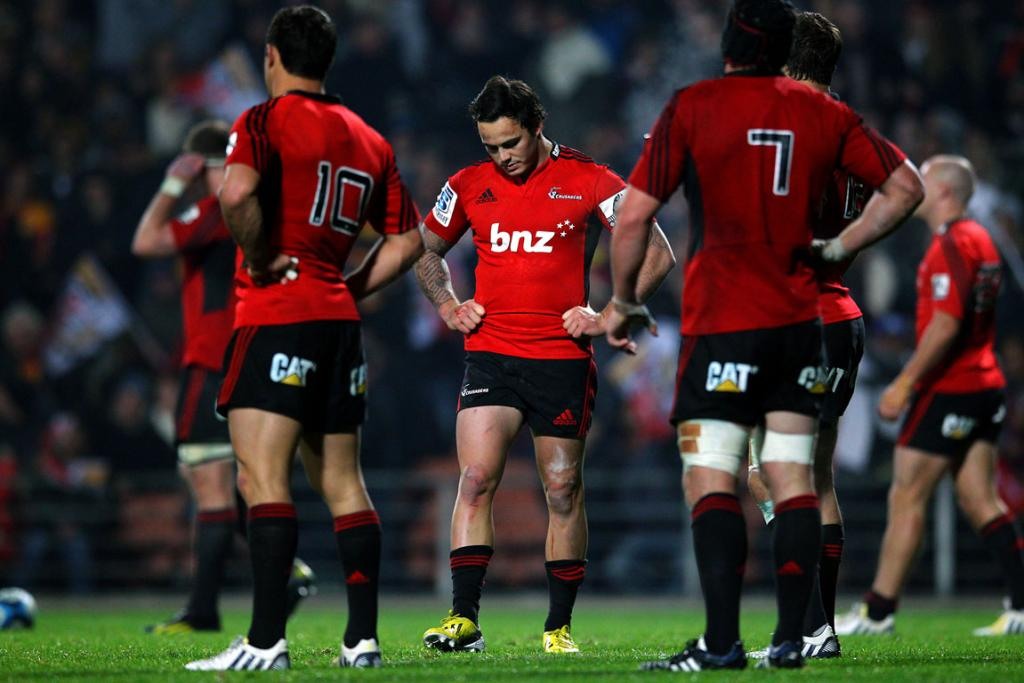 Zac Guildford (centre) and the Crusaders lament their loss to the Chiefs.