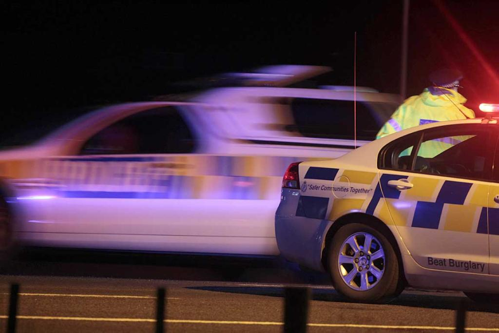 Police cars near the Spring Hill prison in the Waikato, where a riot has broken out
