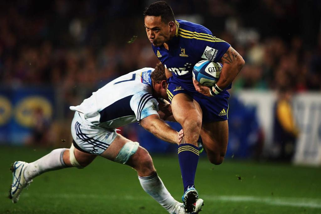 Highlanders wing Hosea Gear gets away from Blues openside Luke Braid.