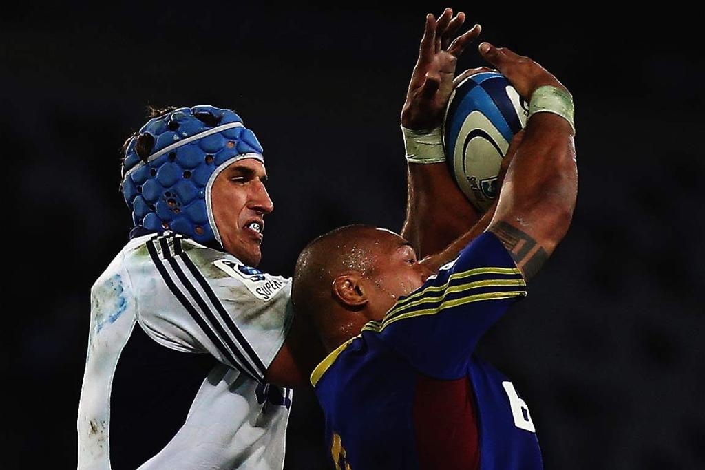 Anthony Boric of the Blues competes with Mose Tuiali'i of the Highlanders in the lineout.