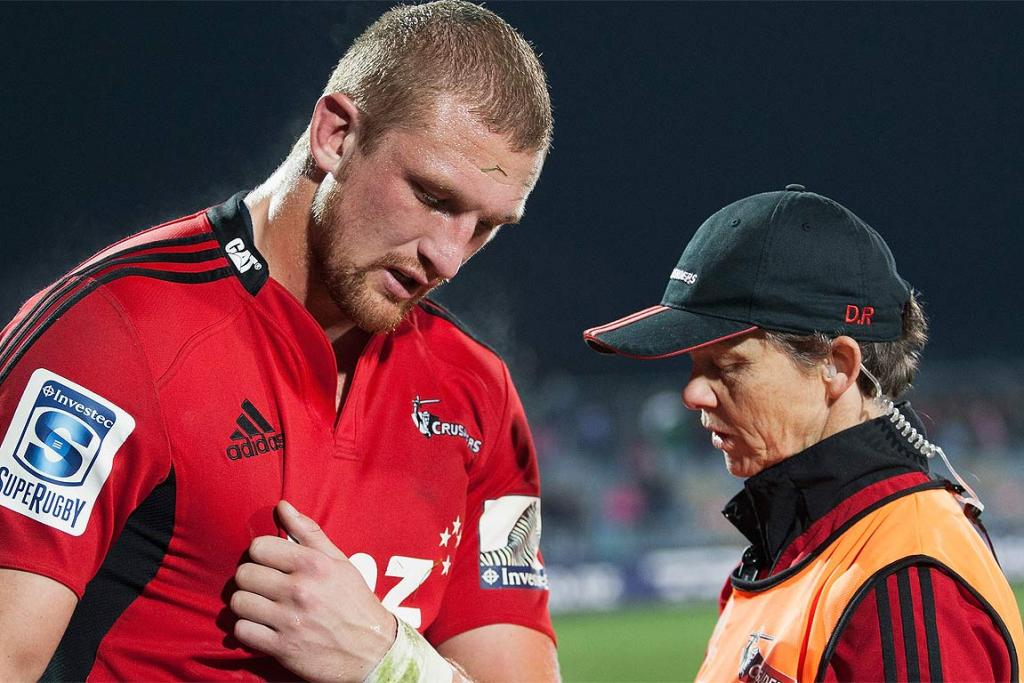 Dominic Bird of the Crusaders attended to by the team doctor during his side's Round 16 clash with the Waratahs in Christchurch.