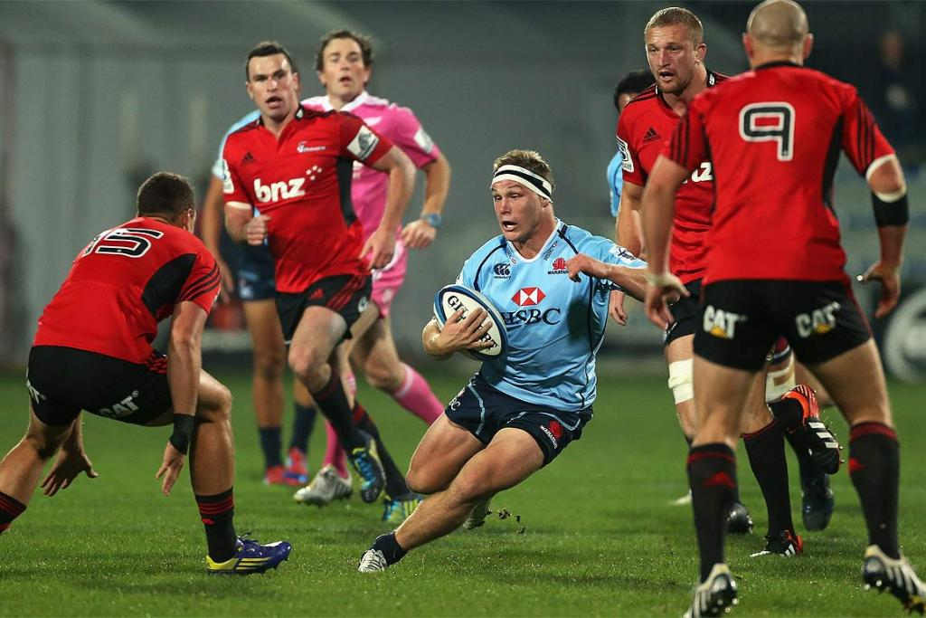 Michael Hopper of the Waratahs makes a charge against the Crusaders at AMI Stadium.