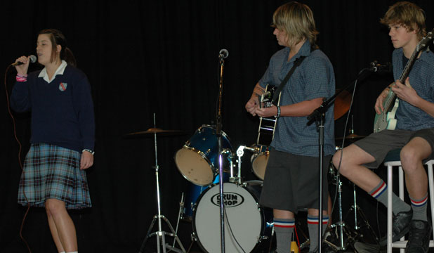 South Otago High School band Loose Enz, from left, Kaitlin Curtin, Taine Michie and Bradley Katon perform at the school assembly after making it to the regional finals of the Smokefree Rockquest.