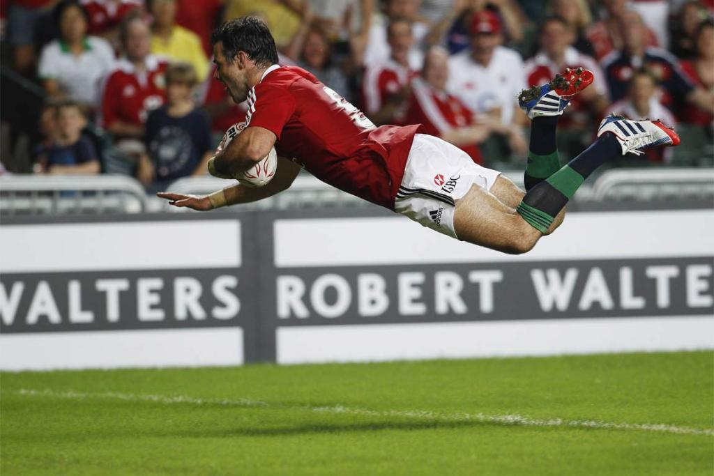 Wales halfback Mike Phillips dives over to score for the Lions against the Barbarians.