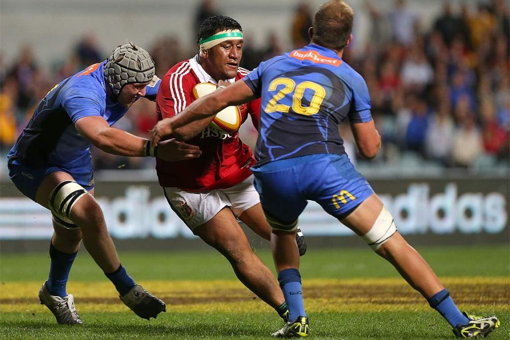 Lions and England prop Mako Vunipola charges at the Force defence.