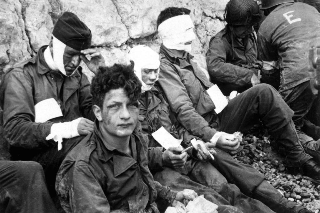 American assault troops of the 16th Infantry Regiment, injured while storming Omaha Beach, wait at Chalk Cliffs for evacuation in this photo taken at Collville-sur-Mer, Normandy, France, June 6, 1944.