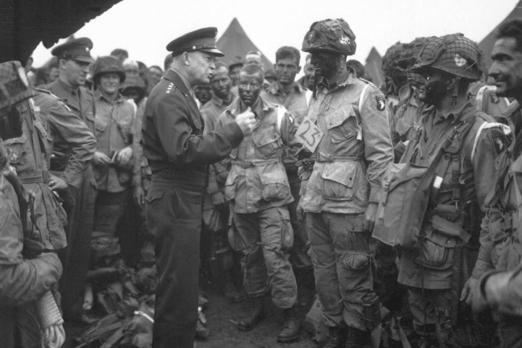 "General Dwight D Eisenhower gives the order of the day, ""full victory - nothing else"", to paratroopers in England, just before they board their airplanes to participate in the first assault in the invasion of the continent of Europe in this file photo from June 6, 1944."