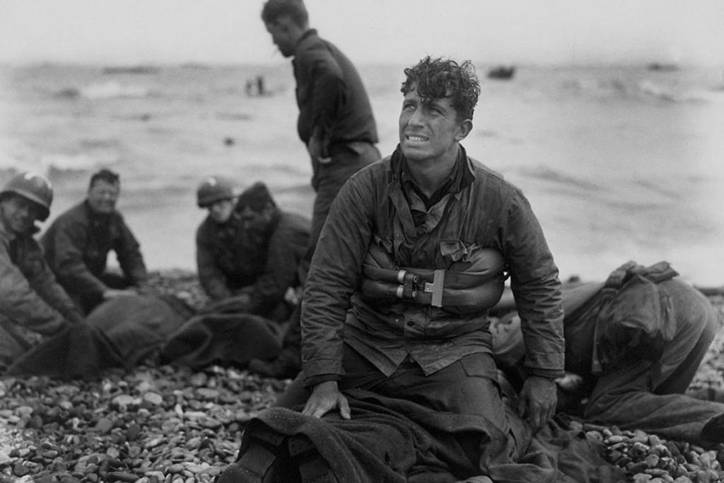 US Army soldiers recover the remains of comrades at Omaha Beach, Normandy, France, in this June 6, 1944 handout photo.