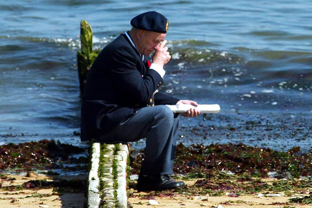 A Canadian veteran sits on Juno beach in Normandy, northern France, for the 60th anniversary of the invasion on June 6, 2004.