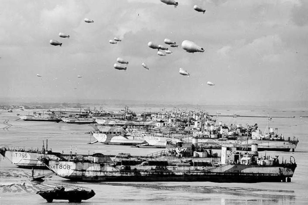 British LCT's line the Normandy shore, each with a barrage balloon designed to discourage enemy air attack in this file photo taken sometime before the D-Day invasion.