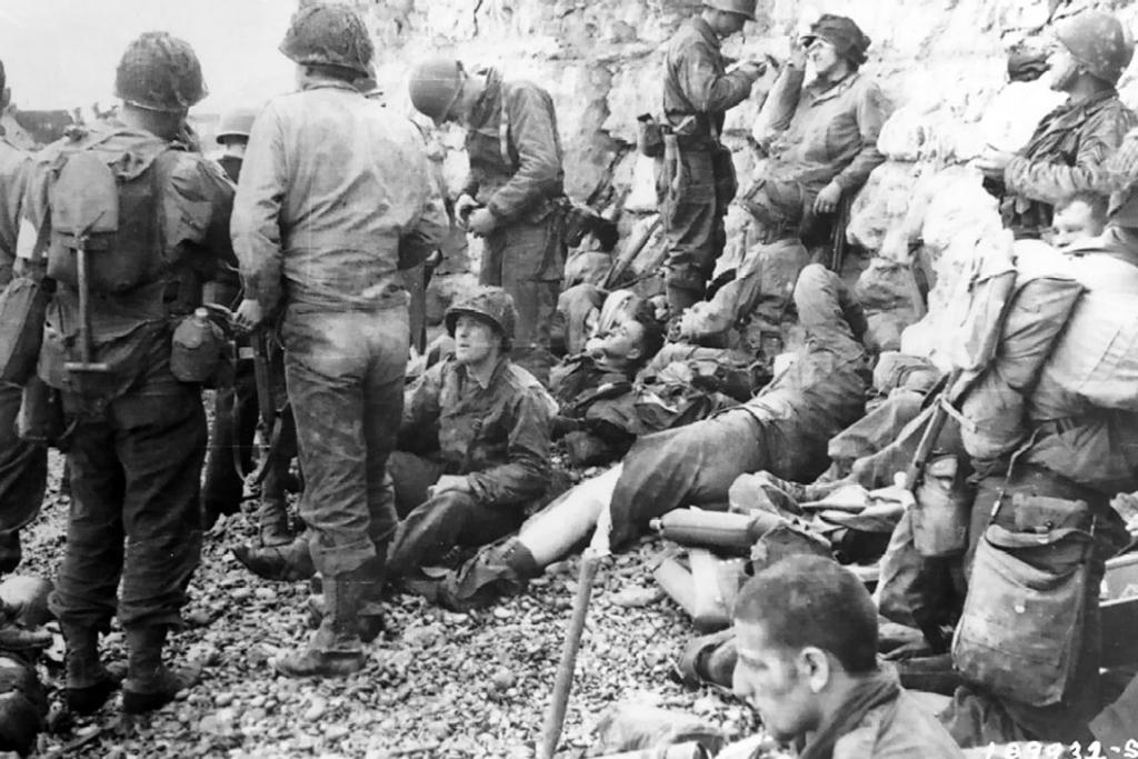 A large group of American assault troops take a breather before moving onto the continent.