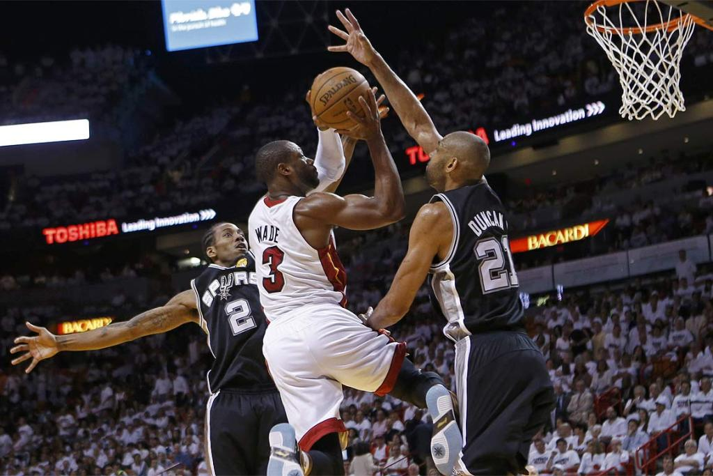 Miami Heat's Dwyane Wade pushes his way towards the net.