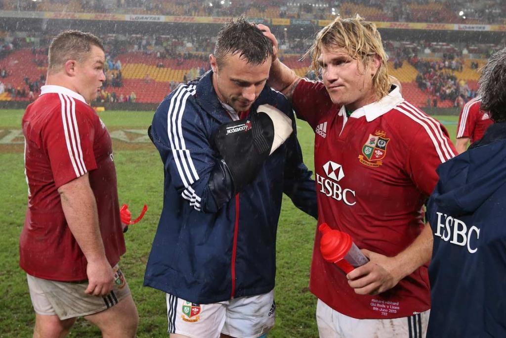 Tommy Bowe, with his right arm in a sling, is consoled by Richard Hibbard.