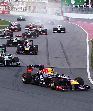 ON HIS WAY: Sebastian Vettel leads the pack into the first turn of the Canadian GP.
