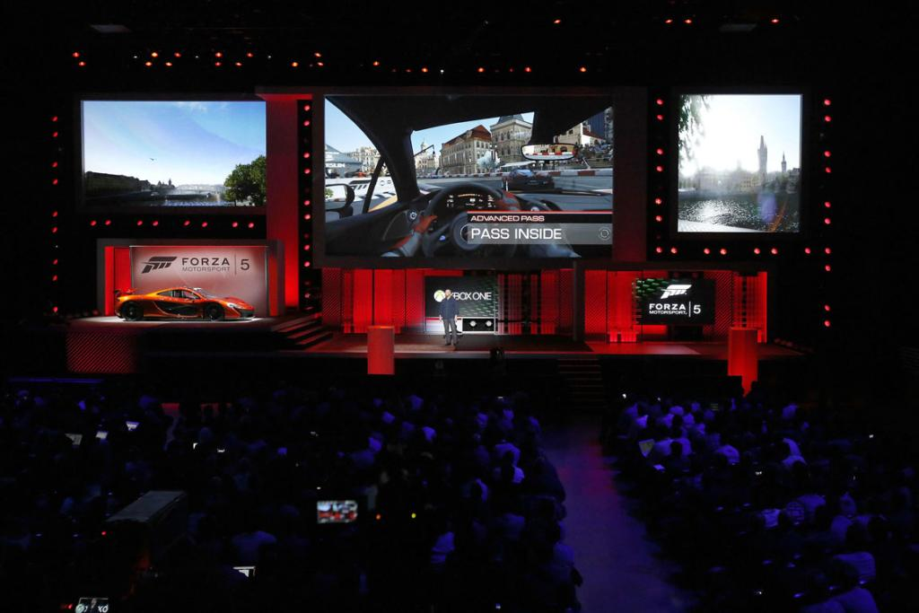 Attendees watch scenes from the game Forza Motorsport 5 during the Xbox E3 Media Briefing.