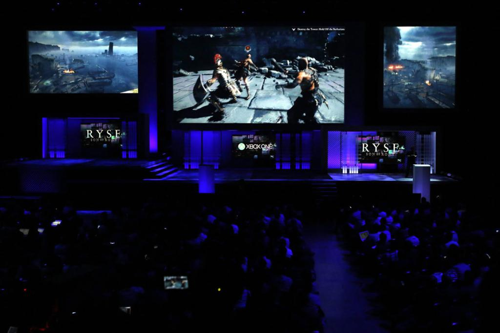 Attendees watch scenes from the game Ryse: Son of Rome during the Xbox E3 Media Briefing.