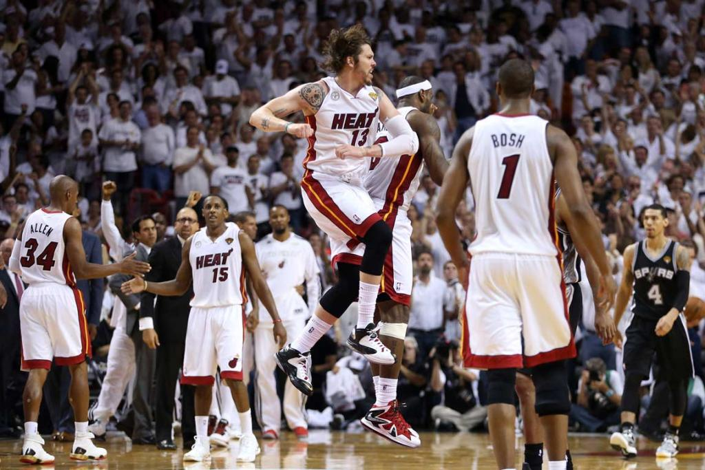 Mike Miller and LeBron James celebrate after a key play.