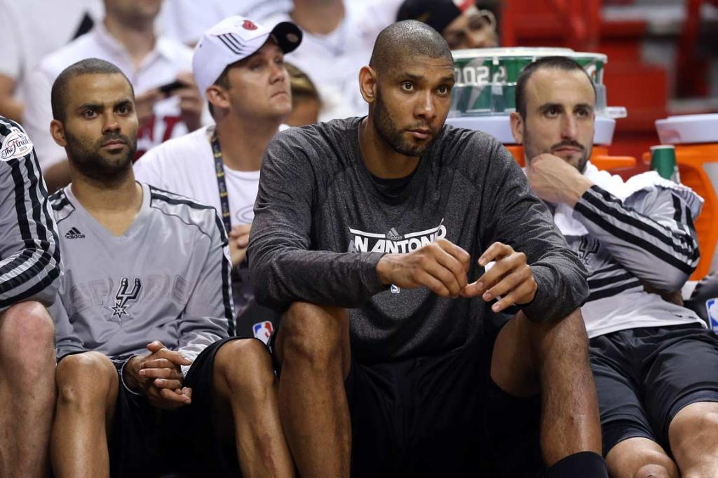 The long faces of the Spurs' big-three (from left) Tony Parker, Tim Duncan and Manu Ginobili in the fourth quarter.