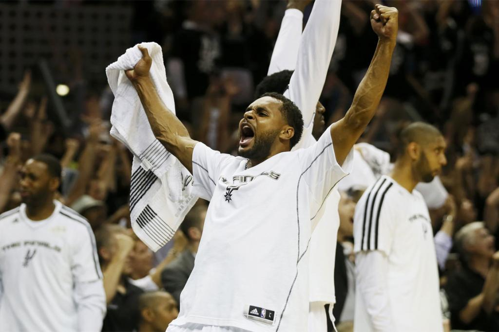 San Antonio Spurs' Patty Mills celebrates during his team's win in Game 3.