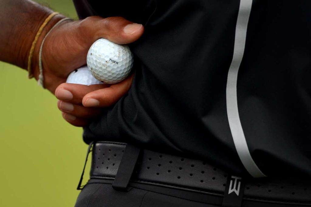 Tiger Woods holds two golf balls during a practice round ahead of the US Open.