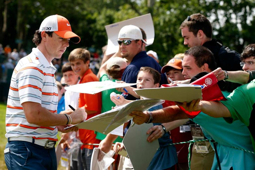 Northern Ireland's Rory McIlroy signs autographs during his practice round.